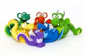 stock photo of molding clay  - Multicolored handmade modelling clay dragons on white - JPG