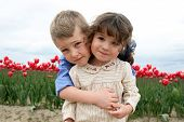 Little Girl and Boy Hugging