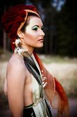 Soft colored portrait of a fashion model with a tribal style. Shoot at dusk for a melancholic effect