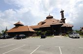 foto of malay  - TERENGGANU, MALAYSIA - APRIL, 2014: Located at Jerteh, Terengganu, Malaysia. Completed in 2012. Designed and crafted by local wood craftsman, the mosque is built according to traditional Malay architectural concept.
