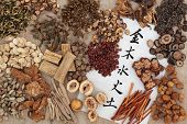 stock photo of ginseng  - Five elements chinese calligraphy script on rice paper with herbal medicine selection - JPG