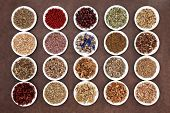 Medicinal and naturopathic herb selection also used in witches magical potions over brown lokta paper background.