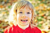 foto of missing teeth  - little girl in fall missing her first tooth - JPG
