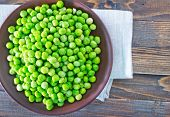 stock photo of green pea  - green peas in bowl on wooden table - JPG