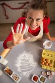 Young Housewife Showing Hand Smeared In Flour