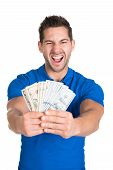Man Screaming While Holding Fanned Us Paper Currency