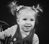 stock photo of ponytail  - portrait of little girl with ponytail hairstyle - JPG