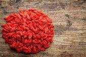 Dried Goji Berries On A Wooden Background