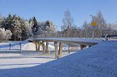 picture of icy road  - Concrete bridge crosses a road - JPG