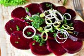 Beetroot salad with chopped onion on the white plate