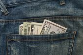 Dollar notes in Jeans front pocket