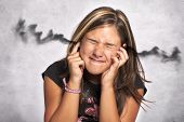 stock photo of noise pollution  - young child with noise in the ears - JPG