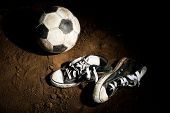 Soccer ball on ground on dark background