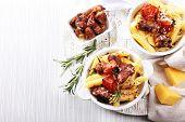 Tasty pasta with meat in ceramic pot