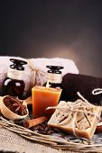 Organic soap with coffee beans, sea salt on wicker mat, on wooden table, on dark background, Coffee spa concept