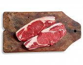 Raw Meat On Wooden Table. Isolated, Clipping Path.