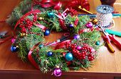 stock photo of handicrafts  - Tools and decorations for making of handicraft christmas wreath - JPG