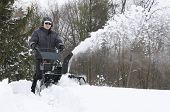 picture of snow shovel  - Snow being removed during winter storm using snow blower - JPG