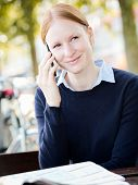 Businesswoman On The Phone In A City Park