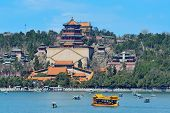 Summer Palace with historical architecture, lake and boat in Beijing.