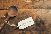 Old wooden spoon with baked with love tag