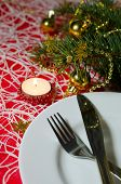 Christmas And New Year Table Place Setting With Christmas Decorations By Candlelight.