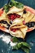pancakes with fruit and berry fillings
