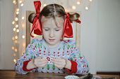 cute little girl in knitted christmas sweater