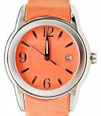 One Minute To Twelve O'clock On Orange Wristwatch