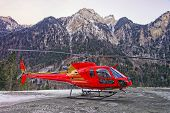 Red Helicopter In Heliport At Swiss Alps
