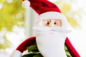 Traditional Santa Claus on bokeh background