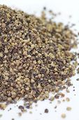 Close - up Black pepper powder on a white background