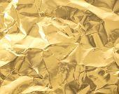Wrinkled golden paper texture.
