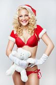 Smile Beautiful And Sexy Woman Dresses As A Sexy Santa Claus