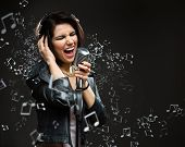 Singing song rock musician with microphone and earphones. Concept of rock music and rave
