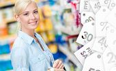 Portrait of young girl at the shop standing near the shelves with cosmetics. Sale time