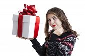 Girl In Sweater Holding Gift Boxes