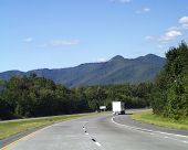 foto of 18 wheeler  - transport vehicle on a lonely highway - JPG