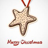 Cookie star. Paper label on ribbon.