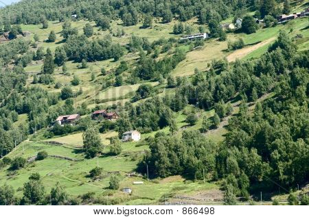 Picture or Photo of A mountain farm on the side of Aurlandsfjord, Sognefjord, in western Norway.