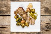 pic of brussels sprouts  - Roast beef cut in slice with broccoli brussels sprouts and mushrooms on white plate - JPG