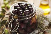 foto of kalamata olives  - jar with pickled kalamata olives - JPG
