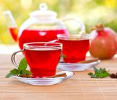 pic of hibiscus  - Two cups of hibiscus tea on the table close up - JPG