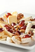 foto of cheese platter  - Assorted Cheeses with Grapes and Nuts on Platter - JPG