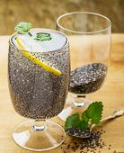 stock photo of glass water  - Chia seeds drink with water in transparent glass with lime and lemon balm - JPG