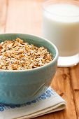 stock photo of porridge  - Oatmeal porridge and glass of milk on white wooden table - JPG