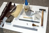 image of leather tool  - Tools materials and pattern for making leather case for mobile phone - JPG
