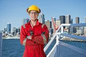 picture of off-shore  - Docker and deck hand posing on the bridge of a ship - JPG