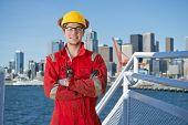 pic of washington skyline  - Docker and deck hand posing on the bridge of a ship - JPG