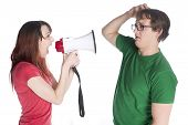foto of shout  - Close up Young Woman Shouting to her Man Scratching his Head with Megaphone - JPG